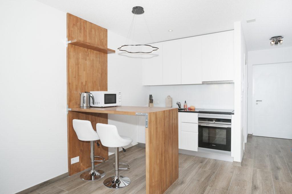conseil Superhost Airbnb : revue des prix pour un loft style industriel à Martigny